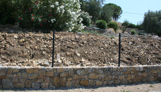 Building a wall in Valbonne - Ace of Spades Gardens