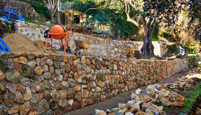 Building a wall in Bar-sur-Loup - Ace of Spades Gardens